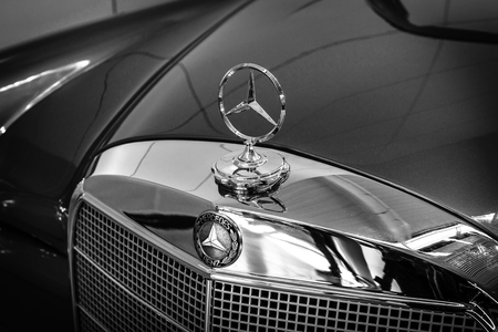 se: STUTTGART, GERMANY - MARCH 18, 2016: Hood ornament of Mercedes-Benz 220 SE (W128), close-up. Black and white. Europes greatest classic car exhibition RETRO CLASSICS