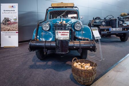 converted: STUTTGART, GERMANY - MARCH 18, 2016: Compact car Opel Olympia OL38, 1938 with wood gas generator by Zanker, 1942. Europes greatest classic car exhibition RETRO CLASSICS