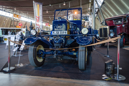 ag: STUTTGART, GERMANY - MARCH 18, 2016: The tractor Lanz Bulldog D2531 (two-stroke, hot bulb engine), manufactured by Heinrich Lanz AG in Mannheim, 1939. Europes greatest classic car exhibition RETRO CLASSICS