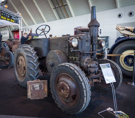 ag: STUTTGART, GERMANY - MARCH 18, 2016: The tractor Lanz Bulldog D7511 (two-stroke, hot bulb engine), manufactured by Heinrich Lanz AG in Mannheim, 1935. Europes greatest classic car exhibition RETRO CLASSICS