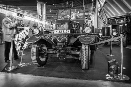 ag: STUTTGART, GERMANY - MARCH 18, 2016: The tractor Lanz Bulldog  D2531 (two-stroke, hot bulb engine), manufactured by Heinrich Lanz AG in Mannheim, 1939. Black and white. Europes greatest classic car exhibition RETRO CLASSICS