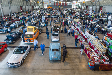 above 18: STUTTGART, GERMANY - MARCH 18, 2016: Different cars and bikes in the exhibition hall. View from above. Europes greatest classic car exhibition RETRO CLASSICS