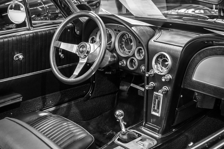 roadster: STUTTGART, GERMANY - MARCH 18, 2016: Cabin of sports car Chevrolet Corvette Roadster Black Old-School Resto Mod, 1967. Black and white. Europes greatest classic car exhibition RETRO CLASSICS Editorial