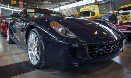 f1: STUTTGART, GERMANY - MARCH 18, 2016: Sports car Ferrari 599 GTB Fiorano F1, 2008. Europes greatest classic car exhibition RETRO CLASSICS