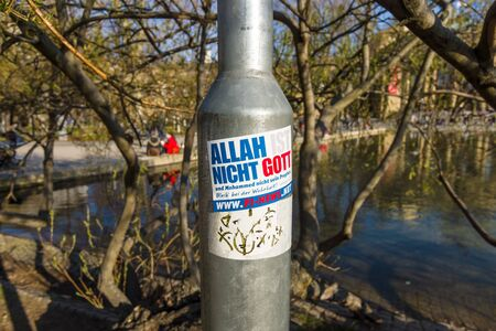 provocative: STUTTGART, GERMANY - MARCH 18, 2016: Provocative sticker on a lamppost. The inscription in German: Allah is not God! Stay Free!