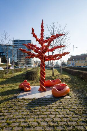 sculptor: STUTTGART, GERMANY - MARCH 18, 2016: Modern art. Red tree (Roter Baum) by sculptor Mariella Mosler, 2005. Stuttgart is the capital and largest city of the state of Baden-Wuerttemberg. Editorial