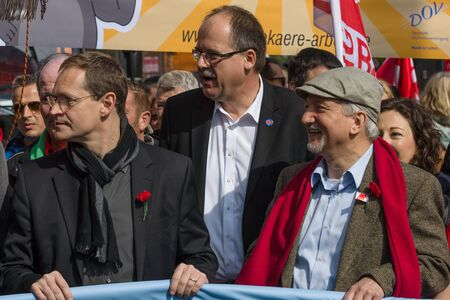 governing: BERLIN - MAY 01, 2016: Governing Mayor of Berlin Michael Mueller (left). Members of trade unions, workers and employees at the demonstration on the occasion of Labour day.