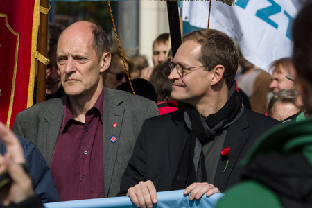 governing: BERLIN - MAY 01, 2016: Governing Mayor of Berlin Michael Mueller (center). Members of trade unions, workers and employees at the demonstration on the occasion of Labour day.