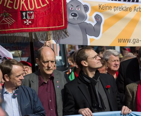 governing: BERLIN - MAY 01, 2016: Governing Mayor of Berlin Michael Mueller (right). Members of trade unions, workers and employees at the demonstration on the occasion of Labour day.