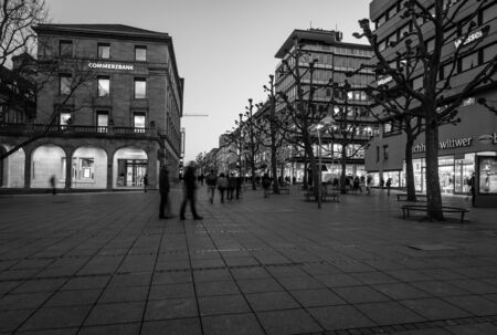 king street: STUTTGART, GERMANY- MARCH 16, 2016: The historic shopping street in the central part of the city - Koenigstrasse (King Street) and Schlossplatz. Black and white. Editorial