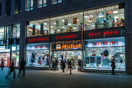 king street: STUTTGART, GERMANY- MARCH 16, 2016: The historic shopping street in the central part of the city - Koenigstrasse (King Street), and a showcase well-known store Mueller. Editorial