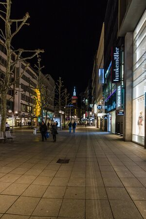 king street: STUTTGART, GERMANY- MARCH 16, 2016: The historic shopping street in the central part of the city - Koenigstrasse (King Street) in the evening lights.