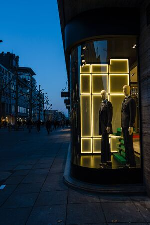king street: STUTTGART, GERMANY- MARCH 16, 2016: The historic shopping street in the central part of the city - Koenigstrasse (King Street) and a showcase boutique BOSS.