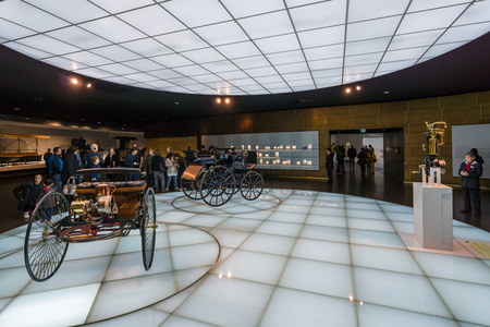 an era: STUTTGART, GERMANY- MARCH 19, 2016: Exhibition Hall with the first cars. Getting car era. Mercedes-Benz Museum. Editorial