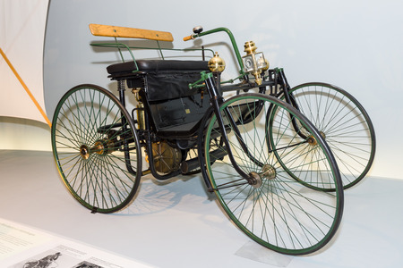 motorized: STUTTGART, GERMANY- MARCH 19, 2016: Daimler motorized quadricycle - the wire-wheel car (Daimler Motor-Quadricycle, Stahlradwagen), 1889. Mercedes-Benz Museum.