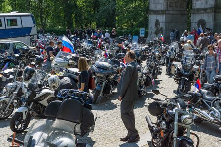 treptow: BERLIN - MAY 09, 2016: Victory Day in Treptower Park. Parked motorcycle of Russian motorcycle club Night Wolves in front of the war memorial.
