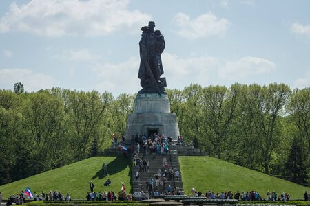 the liberator: BERLIN - MAY 09, 2016: Victory Day in Treptower Park. Soviet War Memorial (Monument to the Liberator Soldier), and numerous guests and visitors.
