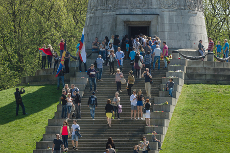 the liberator: BERLIN - MAY 09, 2016: Victory Day in Treptower Park. Guests and visitors at the foot of the monument to the Liberator Soldier.