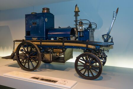 motorized: STUTTGART, GERMANY- MARCH 19, 2016: Daimler motorized fire-fighting pump (Daimler Motor-Feuerspritze), 1892. Mercedes-Benz Museum.