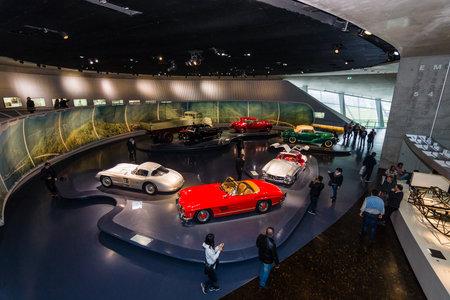postwar: STUTTGART, GERMANY- MARCH 19, 2016: The exhibition hall of the post-war automobile technics. Mercedes-Benz Museum.
