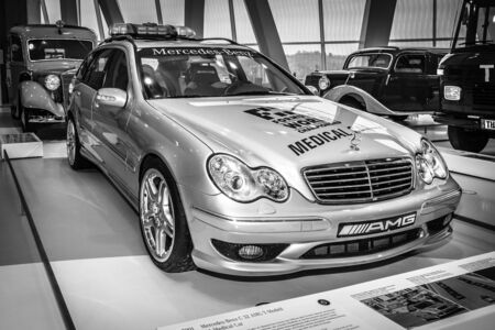 station wagon: STUTTGART, GERMANY- MARCH 19, 2016: Mercedes-Benz C32 AMG station wagon F1 Medical car, 2001. Black and white.  Mercedes-Benz Museum.
