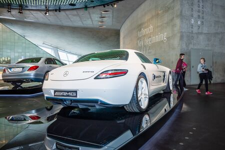 coupe: STUTTGART, GERMANY- MARCH 19, 2016: Luxury car Mercedes-Benz SLS AMG Coupe Electic Drive, 2012. Rear view. Mercedes-Benz Museum. Editorial