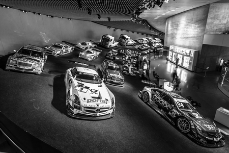 museum rally: STUTTGART, GERMANY- MARCH 19, 2016: Gallery of sports and racing cars of different classes. Black and white. Mercedes-Benz Museum.