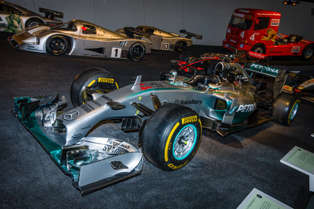 formula one racing: STUTTGART, GERMANY- MARCH 19, 2016: Formula One racing car Mercedes F1 W01 Hybrid, 2014. Mercedes-Benz Museum. Editorial