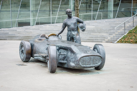 formula one racing: STUTTGART, GERMANY- MARCH 19, 2016: As a tribute to five-time world champion in Formula One racing - Juan Manuel Fangio. The sculptor Joaquim Ros Sabate. Editorial