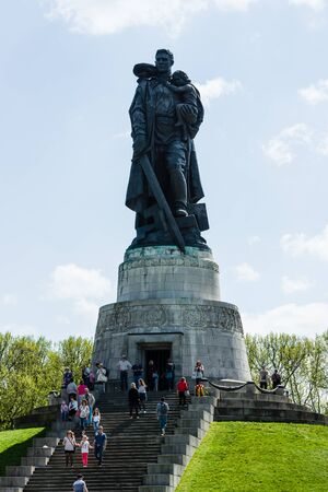 the liberator: BERLIN - MAY 08, 2016: Victory in Europe Day. Treptower Park. Soviet War Memorial (Monument to the Liberator Soldier), and numerous guests and visitors.