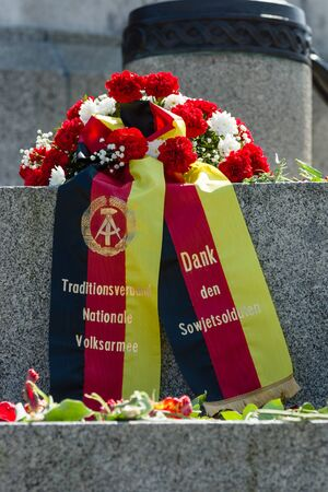 liberator: BERLIN - MAY 08, 2016: Victory in Europe Day. A wreath in the colors of the German flag at the foot of the monument to Soldier - liberator in the Soviet War Memorial in Treptower Park. The inscription in German: Thanks to Soviet soldiers. Editorial