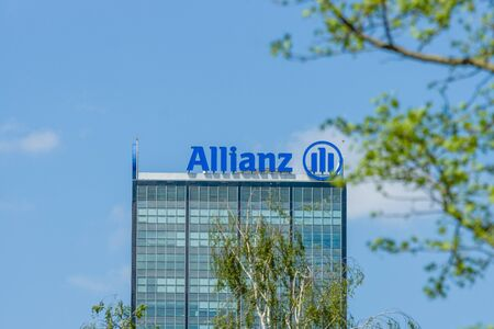 tree world tree service: BERLIN, GERMANY - MAY 08, 2016: The Allianz complex in Alt-Treptow. Allianz is a German multinational financial services company, the largest insurance company in the world.