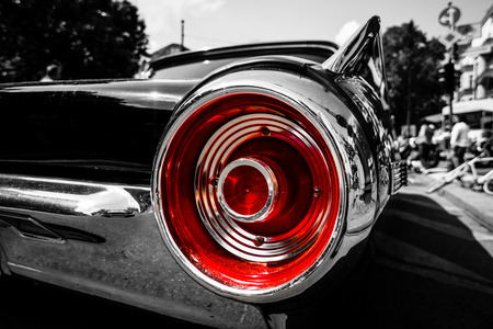 thunderbird: BERLIN - JUNE 05, 2016: Stoplight of a personal luxury car Ford Thunderbird (third generation). Close-up. Combined toning. Black-and-white-red. Classic Days Berlin 2016. Editorial