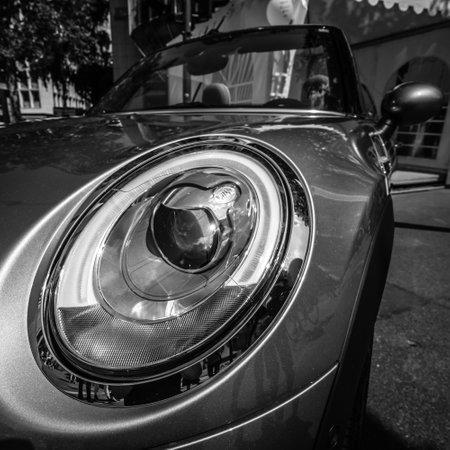 cooper: BERLIN - JUNE 05, 2016: Headlamp of a city car Mini Cooper S Convertible. Black and white. Classic Days Berlin 2016.