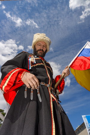 east berlin: BERLIN - JUNE 11, 2016: Russian Cossack with the Russian flag. German-Russian festival devoted to the Independence Day of Russia. District Karlshorst, East Berlin.