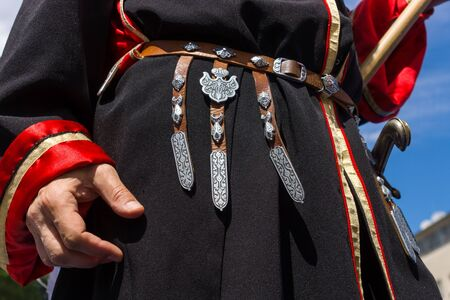 east berlin: BERLIN - JUNE 11, 2016: Russian Cossack shows decorative details of the uniforms. German-Russian festival devoted to the Independence Day of Russia. District Karlshorst, East Berlin.