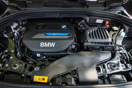 engine compartment: BERLIN - JUNE 05, 2016: Engine of compact MPV BMW 225e Active Tourer, Plug-in-Hybrid. Classic Days Berlin 2016.