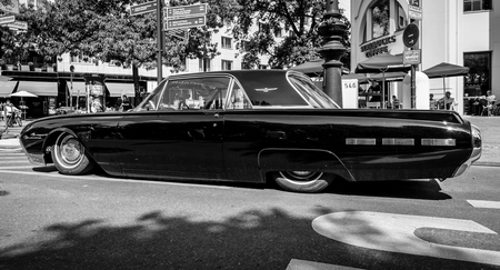 thunderbird: BERLIN - JUNE 05, 2016: Personal luxury car Ford Thunderbird (third generation). Lowrider. Black and white. Classic Days Berlin 2016. Editorial