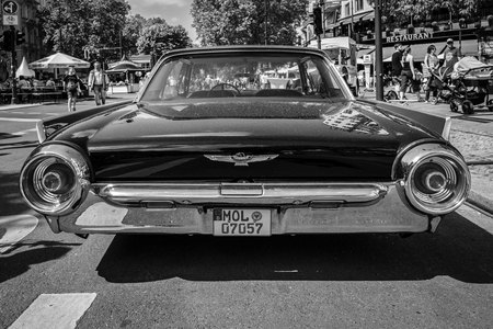 thunderbird: BERLIN - JUNE 05, 2016: Personal luxury car Ford Thunderbird (third generation). Lowrider. Rear view. Black and white. Classic Days Berlin 2016. Editorial