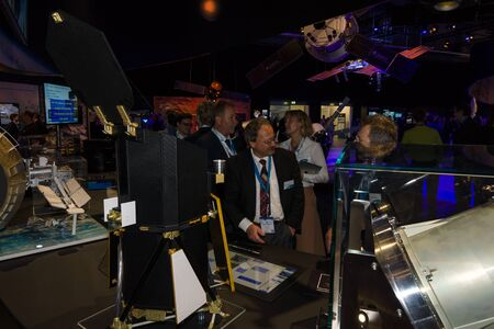 astronautics: BERLIN, GERMANY - JUNE 01, 2016: The specialists on the stand of German Max Planck Institute for Extraterrestrial Physics. Exhibition ILA Berlin Air Show 2016