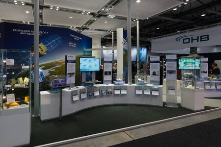 astronautics: BERLIN, GERMANY - JUNE 01, 2016: The stand of Fraunhofer Society. Exhibition ILA Berlin Air Show 2016