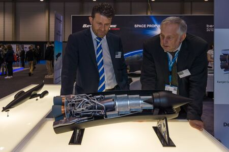 propulsion: BERLIN, GERMANY - JUNE 01, 2016: The stand of company Bayern-Chemie (Germany), develops and produces solid fuel propulsion systems for tactical guided missiles. Exhibition ILA Berlin Air Show 2016