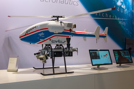 aerospace: BERLIN, GERMANY - JUNE 01, 2016: The stand of German Aerospace Center (DLR). Helicopter Drone SuperARTIS (Autonomous Rotorcraft Testbed for Intelligent Systems). Exhibition ILA Berlin Air Show 2016.