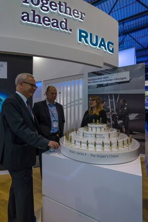 weaponry: BERLIN, GERMANY - JUNE 01, 2016: The stand the company RUAG Ammotec, manufacturer of small arms ammunition up to 12.7 mm for defence, law enforcement, hunting and sport. Exhibition ILA Berlin Air Show 2016.