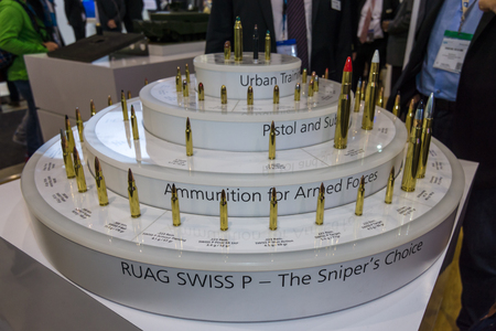 law enforcement: BERLIN, GERMANY - JUNE 01, 2016: The stand the company RUAG Ammotec, manufacturer of small arms ammunition up to 12.7 mm for defence, law enforcement, hunting and sport. Exhibition ILA Berlin Air Show 2016.