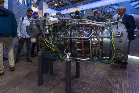 ag: BERLIN, GERMANY - JUNE 01, 2016: The stand of MTU Aero Engines AG, is a German aircraft engine manufacturer. Exhibition ILA Berlin Air Show 2016.