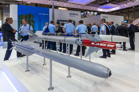 missiles: BERLIN, GERMANY - JUNE 01, 2016: The stand of Diehl Defence. Models of military missiles AIM-2000 IRIS-T and Laser-Guided Sidewinder (LaGS). Exhibition ILA Berlin Air Show 2016.