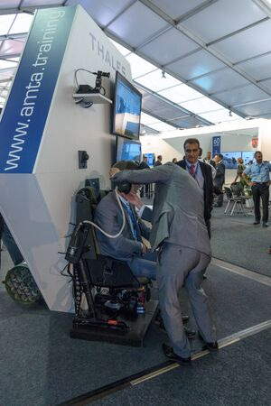 manoeuvre: BERLIN, GERMANY - JUNE 01, 2016: The stand of Air Manoeuvre Training Alliance in cooperation with Thales Defence & Security Systems GmbH. Helicopter simulator. Exhibition ILA Berlin Air Show 2016.