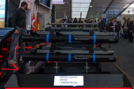 long range: BERLIN, GERMANY - JUNE 01, 2016: The stand of Roketsan, is a major Turkish weapons manufacturer and defense. In the foreground Mizrak-U, is a long range air-to-surface anti-tank missile. Exhibition ILA Berlin Air Show 2016. Editorial