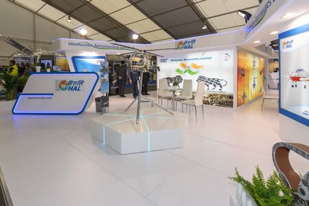 aeronautics: BERLIN, GERMANY - JUNE 01, 2016: The stand of Hindustan Aeronautics Ltd. Model of utility helicopter HAL Dhruv. Exhibition ILA Berlin Air Show 2016.
